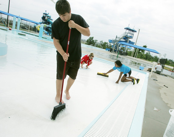 Globe/Roger Nomer<br /> (from left) Lifeguards Jaxson Roberts, Brittany Larery and Danielle Walker clean Cunningham Pool in preparation for its opening this holiday weekend.