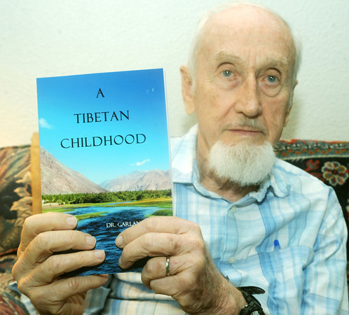 """Globe/Roger Nomer<br /> Garland Bare poses with his book """"A Tibetan Childhood."""""""