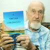 "Globe/Roger Nomer<br /> Garland Bare poses with his book ""A Tibetan Childhood."""