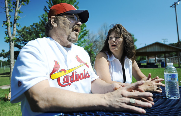 Globe/T. Rob Brown<br /> Mark Lindquist and his wife, Carolyn, talk about his continuing medical visits while at Southwest City Park on the Honey Creek branch of Elk River Tuesday morning, May 22, 2012.