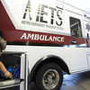 Globe/T. Rob Brown<br /> Alexis Jeffers, EMT, checks a Joplin's METS ambulance Thursday afternoon, May 10, 2012, to make sure it's ready to go when needed. The ambulance service was part of the EF-5 Tornado Disaster Medical Strike Team on May 22, 2011.