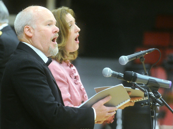"""Globe/Roger Nomer<br /> Soprano soloist Jennifer Bird and tenor soloist Bjorn Arvidsson perform a song from """"The Other Side of Storm"""" on Saturday evening at Memorial Hall."""