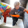 Globe/T. Rob Brown<br /> Volunteers Bobbie Dodson, left, of Orinda, Calif., and Joan Breece, of Lafayette, Calif., both from Lafayette-Orinda Presbyterian Church and volunteering through Catholic Charities, clean the new bathtub Tuesday morning, May 8, 2012, in the new Jump family home in Joplin.
