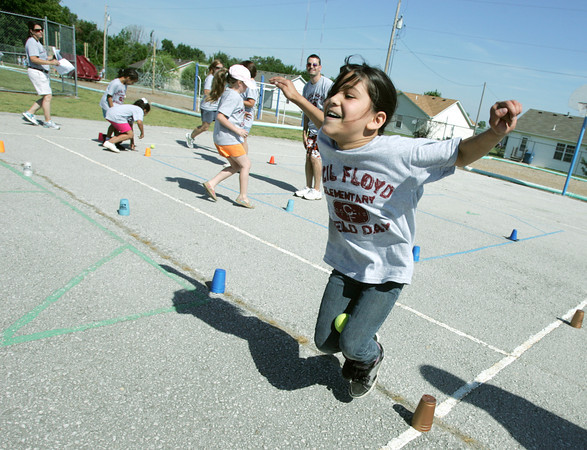 Globe/Roger Nomer<br /> Loilei Pelep, second grader at Cecil Floyd Elementary, runs a relay race with a tennis ball between her knees during the school's annual Field Day on Thursday morning.