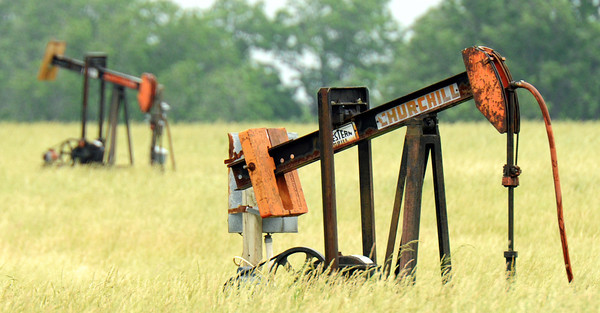 Globe/T. Rob Brown<br /> Two of the many oil pumps on a property 14 miles west of Girard, Kan., Thursday afternoon, May 24, 2012.