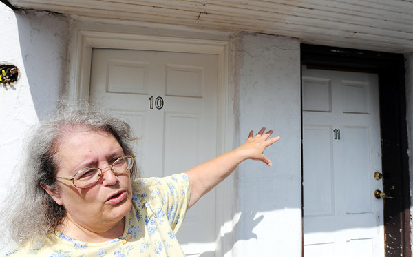 Globe/T. Rob Brown<br /> Deborah Harvey, of Carthage, co-owner of the Boots Motel in Carthage talks about the custom doors that were cut at odd angles, such as the top of Room 10, Tuesday morning, May 1, 2012, at the Route 66 landmark.