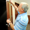 Globe/T. Rob Brown<br /> The Rev. John Myers, pastor of Joplin Full Gospel, locks the door to a storm shelter room Wednesday, May 9, 2012, at the new church building in Joplin.