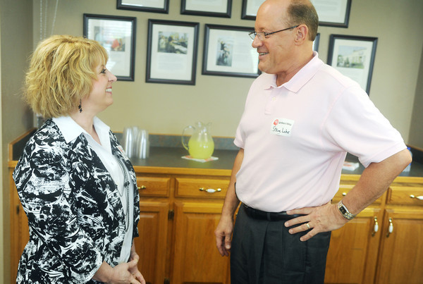 Globe/Roger Nomer<br /> New United Way Director Bev Crespino-Graham talks with Steven Lohr, executive director of Southeast Kansas Community Action Program, during a reception on Thursday.