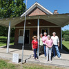 Globe/T. Rob Brown<br /> Cave Springs School's, from left, Wanda Tackett, of Stott City, Helen Hunter, of Carthage, Pat Beasley, of Carl Junction, Betty Still, of Carthage, and Jan Whitworth, of Joplin, stand in front of the school Thursday morning, May 10, 2012, where most of them attended. Beasley, Whitworth, Hunter and Still are all sisters who grew up in the Cave Springs area, just north of Sarcoxie. The historic school was in operation from 1838-1966 and was restored in 2007. It also served as a Civil War Union militia headquarters and as the Jasper County Courthouse from 1865-1866.