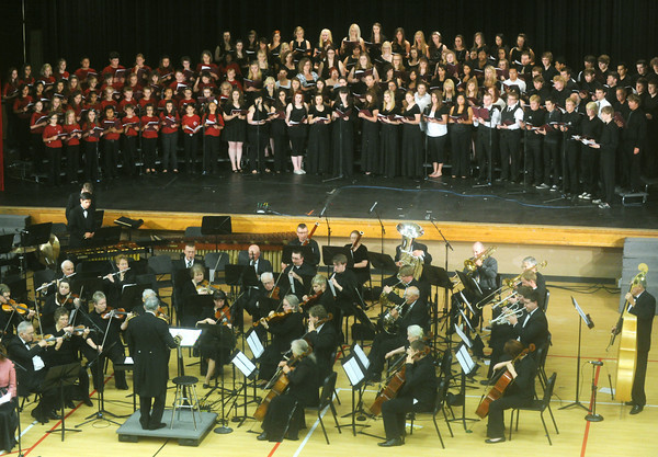 "Globe/Roger Nomer<br /> The Grand Chorus and orchestra perform a selection from ""The Other Side of Storm"" on Saturday evening at Memorial Hall."