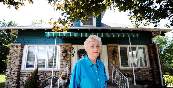 "Globe/T. Rob Brown<br /> Anna ""Frankie"" Hale stands Thursday afternoon, May 31, 2012, in front of the Joplin home her father built for her mother while her mother was expecting her."