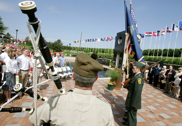 Globe/Roger Nomer<br /> Joel Wren, from the Great Highland Bagpipes, escorts the Pittsburg State University ROTC Color Guard into the PSU Veterans Memorial during a Memorial Day Ceremony on Monday, May 28, 2012.