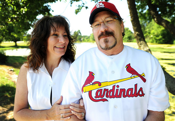 Globe/T. Rob Brown<br /> Mark Lindquist spends time with his wife, Carolyn, at Southwest City Park on the Honey Creek branch of Elk River Tuesday morning, May 22, 2012.