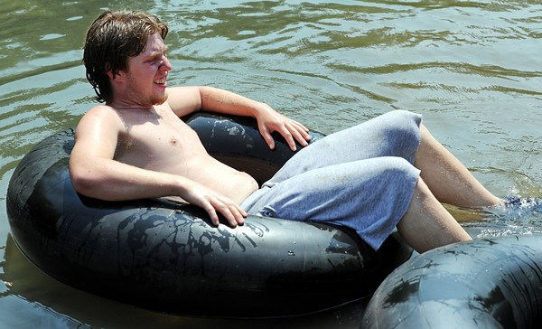 Globe/T. Rob Brown<br /> Justin Deal, of Joplin, relaxes in an inner tube Friday afternoon, May 25, 2012, at the Stone's Corner Public Fishing Access, Missouri Conservation Department, on North Main Street/43 Highway, for Center Creek.