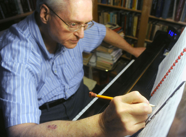 """Globe/Roger Nomer<br /> Hubert Bird makes notes on the score of """"The Other Side of Storm,"""" a musical piece he composed in reaction to the Joplin tornado."""