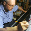 "Globe/Roger Nomer<br /> Hubert Bird makes notes on the score of ""The Other Side of Storm,"" a musical piece he composed in reaction to the Joplin tornado."