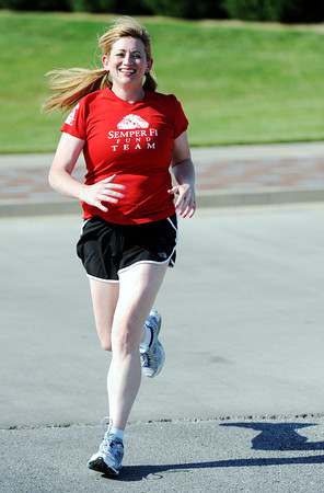 Globe/T. Rob Brown<br /> Kimberly Harries, of Pittsburg, Kan., goes for a run at Pittsburg State University before Wednesday, May 23, 2012. Harries, who ran in the Marine Corps Marathon in 2004 is prepping for the 2012 event.