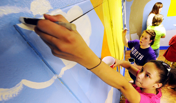 Globe/T. Rob Brown<br /> Unique Moore, 13. of Joplin, paints the clouds of a mural Wednesday afternoon, May 16, 2012, at the Joplin Boys & Girls Club.
