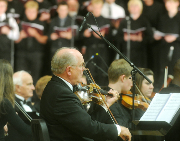 """Globe/Roger Nomer<br /> Louis Hoyt, Neodesha, performs with the orchestra during """"The Other Side of Storm"""" on Saturday evening at Memorial Hall."""