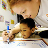 Globe/T. Rob Brown<br /> Amanda Downum, of Joplin, and her son Braedyn Nivens, 3, also of Joplin, work together to draw a picture of his dream playground Thurssday afternoon, May 17, 2012, at Joplin Head Start on North Main Street. A group of children each drew and reported on their ideal playground to parents, educators, and PNC officials.