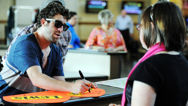 Globe/T. Rob Brown<br /> Top-10 finalist from American Idol, Elliot Yamin, left, signs autographs Monday afternoon, May 7, 2012, for fans at the Branson Airport.