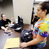 Globe/T. Rob Brown<br /> Megan Wawryzyniak, right, of Joplin, a junior education major, checks with Jessica Way, scholarship clerk, Thursday afternoon, May 31, 2012, about the status of her financial aid in the university's financial aid department at Hearnes Hall.