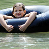 "Globe/T. Rob Brown<br /> Hailey Gordon, 10, of Carl Junction, ""steals"" a friend's inner tube for a lazy creek ride Friday afternoon, May 25, 2012, at the Stone's Corner Public Fishing Access, Missouri Conservation Department, on North Main Street/43 Highway, for Center Creek."
