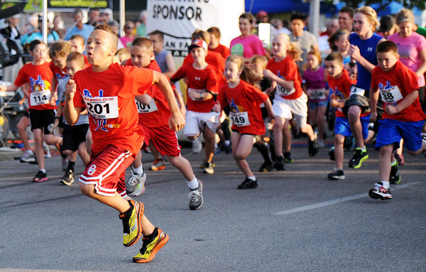 Globe/T. Rob Brown<br /> Tyrese Sisson, of Owasso, Okla., 12, takes the lead at the start of the kids 1-mile run Saturday morning, May 19, 2012, during the Joplin Memorial Run in downtown Joplin.