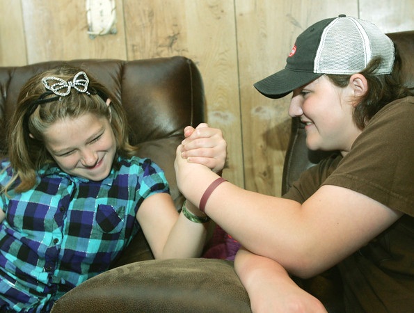 Globe/Roger Nomer<br /> Mason Lillard challenges her cousin Lage Grigsby to an arm wrestling match.