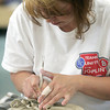 Globe/Roger Nomer<br /> Angel Brame works on a bowl using a pottery wheel at Phoenix Fired Arts on Thursday.