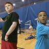 Globe/Roger Nomer<br /> Luke Loveall, 12, left, and Quinton Renfro, 6, play a game of Wii tennis at the South YMCA on Tuesday.