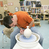 Globe/Roger Nomer<br /> Brent Skinner works with a vase on a pottery wheel at Phoenix Fired Art on Thursday.