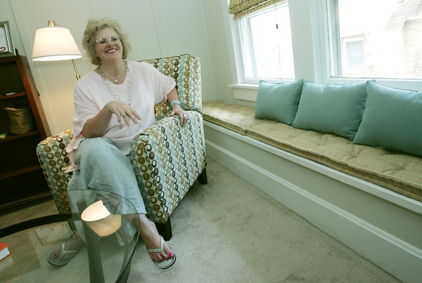 Globe/Roger Nomer<br /> Ann Leach talks about the living room of her Creative Cottage.