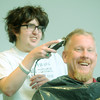 Globe/Roger Nomer<br /> Cooper Vocelka, junior, shaves the head of Dan Hueller, senior principal at Joplin High School, on Friday afternoon at the Joplin High 11/12th grade campus.  Hueller pledged to shave his head if Joplin High student raised $1,500 to help Vocelka with transportation costs associated with treatments for his brain tumor.  Students raised $1,634.66 in one week, so Hueller kept his side of the bargain.