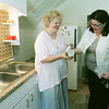 Globe/Roger Nomer<br /> Ann Leach, left, and Lisa Nelson look at drinking cups inside the kitchen of the Creative Cottage.