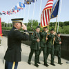 Globe/Roger Nomer<br /> Lt. Col. Christopher Lambert salutes the Pittsburg State University ROTC Color Guard during a Memorial Day ceremony at the PSU Veterans Memorial on Monday, May 28, 2012.