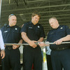 Globe/Roger Nomer<br /> Firefighters uncouple a hose at Fire Station #6 to ceremonially open the station on Saturday morning.