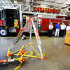 Globe/T. Rob Brown<br /> A Res-Q-Jack, center, is donated by the Firehouse Subs Public Safety Foundation, as Joplin Fire Chief Mitch Randles speaks Wednesday morning, May 2, 2012, to thank them and the sub chain's customers for the donation at the Joplin Fire Station No. 1 in the Donald E. Clark Public Safety and Justice Center.