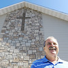 Globe/T. Rob Brown<br /> The Rev. John Myers, pastor of Joplin Full Gospel stands in front of the rebuilt church Thursday morning, May 10, 2012, in Joplin.