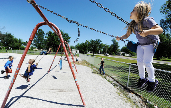 Globe/T. Rob Brown<br /> Karsyn Boston, Webb City Webster Primary School first grader, swings Wednesday morning, May 9, 2012, during recess.