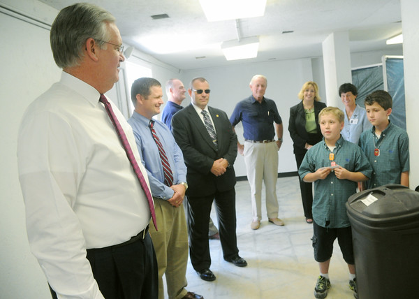 Globe/Roger Nomer<br /> Gov. Jay Nixon and Joplin Superintendent CJ Huff get a tours of a storm shelter at Emerson Elementary from Brandon, left, and Brett Woehl, fourth graders, on Monday afternoon.
