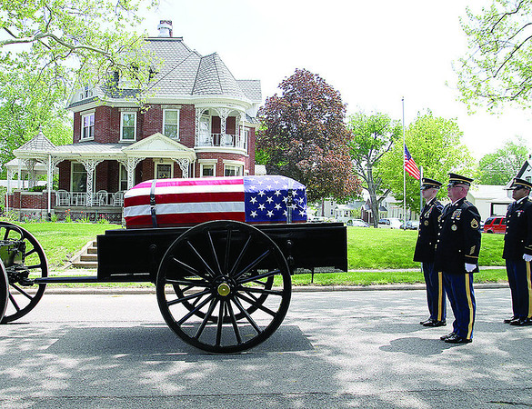 SAM HOUSEHOLDER | THE GOSHEN NEWS<br /> The funeral procession for Otis Bowen stopped the casket in front of the former governor's home on Center Street in Bremen, Ind. Friday May 10, 2013.