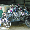 Larry Lee examines one of the bicycles to be sold at the Lebanon Street Department's annual auction Thursday.