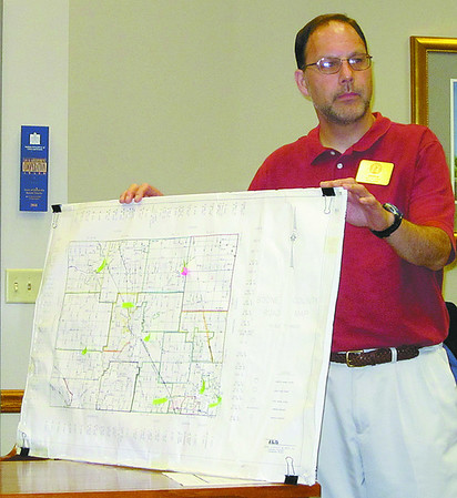 Andrew Wood, Boone County Deputy Clerk for Elections, with a map showing proposed voting sites, marked by green arrows, for next year's election.