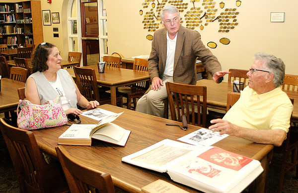 Rod Rose The Lebanon Reporter<br /> Lebanon Public Library Board president Richard Milam (center) shares anecdotes with Sharon Webb and Ron Neese, both relatives of Ralph W. Stark, during Ralph Stark Day at the library.