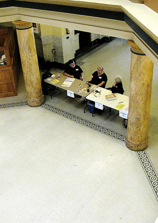 Rod Rose The Lebanon Reporter<br /> Poll workers in the Boone County Courthouse rotunda said less than 100 people had voted when this photo was taken, about 4 p.m.
