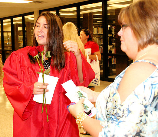 Rod Rose The Lebanon Reporter<br /> Brandy Barrnett (left) and Missy HUmphreys wait to greet another Western Boone High School senior during the school's annual senior walk Friday afternoon.