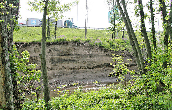 Rod Rose The Lebanon Reporter<br /> A massive swath of Prairie Creek's east bank, north of the Farm Heritage Trail, has been washed away. The collapse is close to the southbound lanes of Interstate 65.
