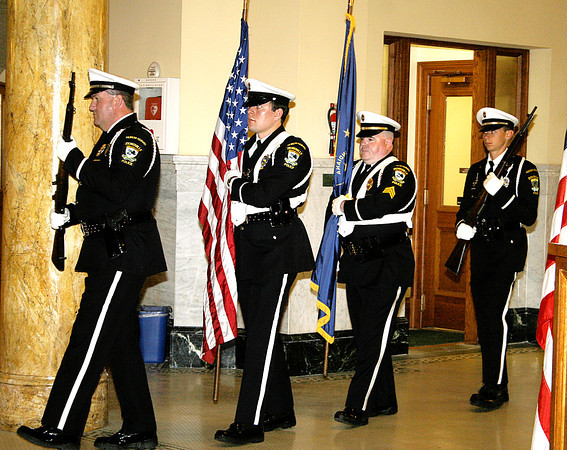 Rod Rose The Lebanon Reporter<br /> The Zionsville Police Department Honor Guard advances the colors at the beginning of a police officer memorial ceremony Wednesday.