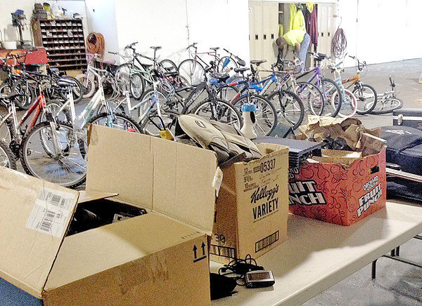 Submitted photo<br /> A row of bicycles, and boxes of items, including 20 men's and women's watches, are prepared for today's 6 p.m. auction at the Lebanon Street Department, 1201 Lafayette Avenue, Lebanon. The watches, and several other items, have been added to the auction.